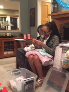 Jasmine opens a gift for her baby girl